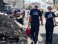 World Vets Disaster Responders, Dr. Springer Browne and Dr. Helle Hydeskov, walk through Guiuan providing veterinary care and performing an initial assessment of veterinary needs.