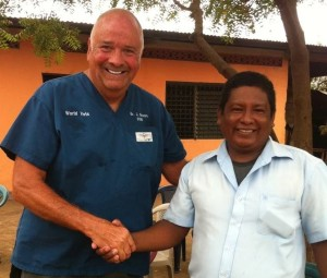 World Vets field service veterinarian, Dr Jerry Brown, with MINSA employee at community outreach clinic; Nicaragua