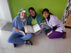 World Vets volunteer Dr Laurie Clauss sits with Peruvian veterinarians Dr Carmen Caceres and associate