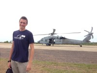 World Vets veterinarian, Dr. Mitch Cooper, gets ready to travel on a helicopter